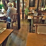 A very small restaurant attached to the pub overlooks a lovely garden with views of South Downs