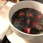 Red beet borscht with homemade mushroom dumplings