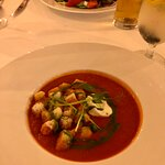 Tomato soup with croutons and basil oil (appetizer)