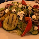 Salad with grilled vegetables - zucchinis, bell peppers, eggplants, olives, tomatoes, and cheese