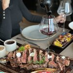 Delicious steak cuts perfectly paired with red wine.