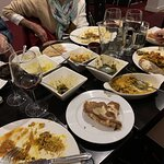Our meal of 4 mains, 4 sides, 4 subdries with a nice bottle of red