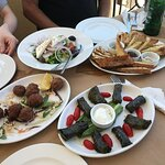 Fried meatballs, Greek salad, bread & pita with dips, and stuffed grape leaves