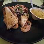 Grilled chicken breast with goat cheese,mascarpone sweet potatoes,mango chutney, cashew nuts. It