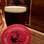 Guinness with the Dead Rabbit coaster