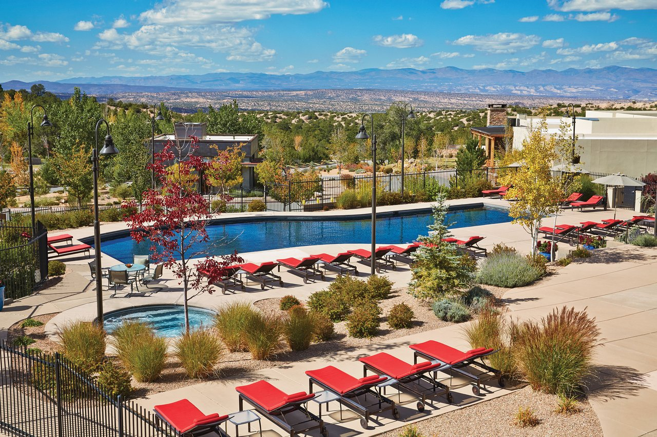Resort pool with red chaise lounges in Santa Fe