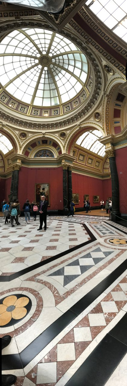 A panoramic shot, top to bottom, in one of the many halls and galleries of this beautiful building.