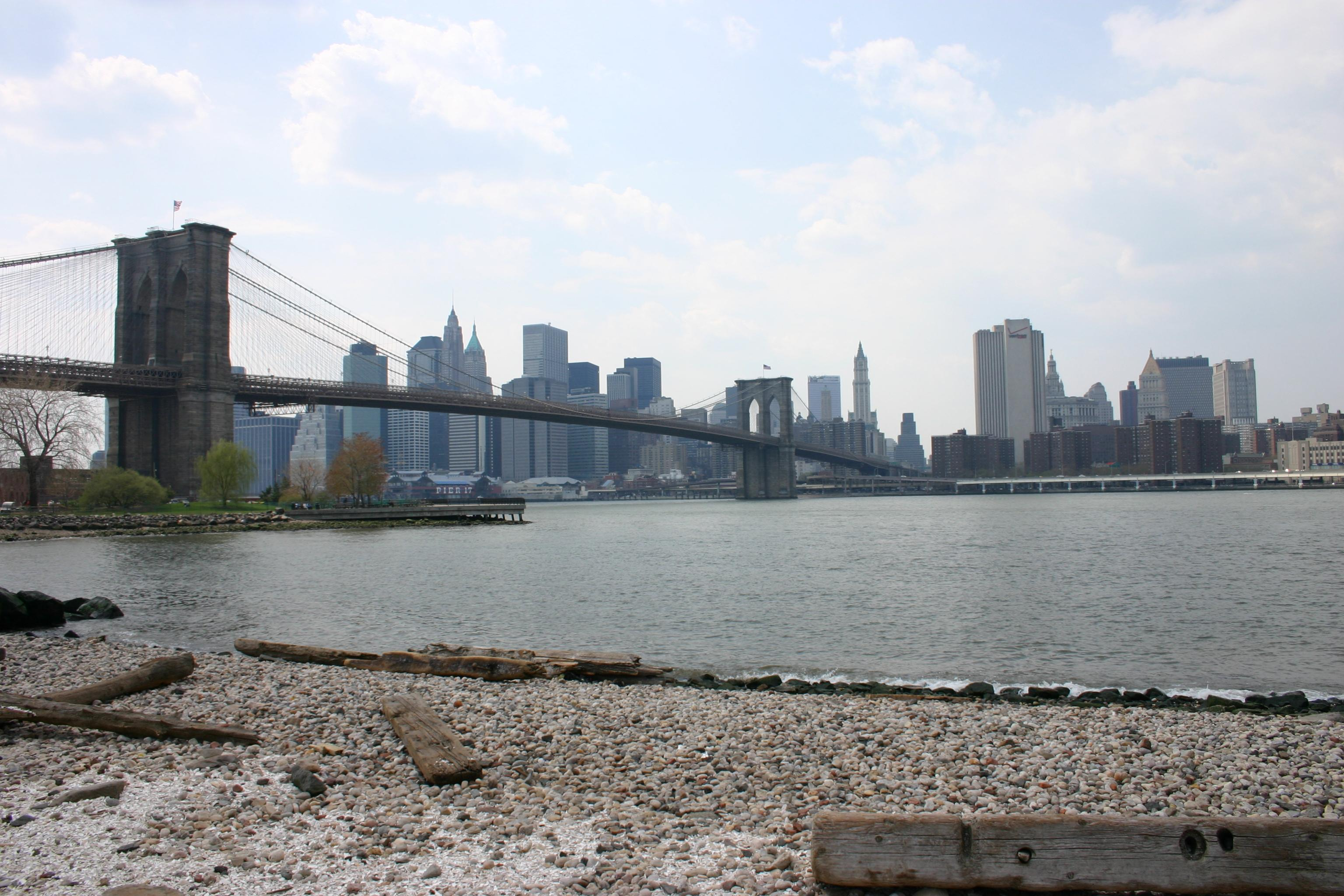 Walk across Brooklyn Bridge, turn left and admire the view of Manhattan across the river.