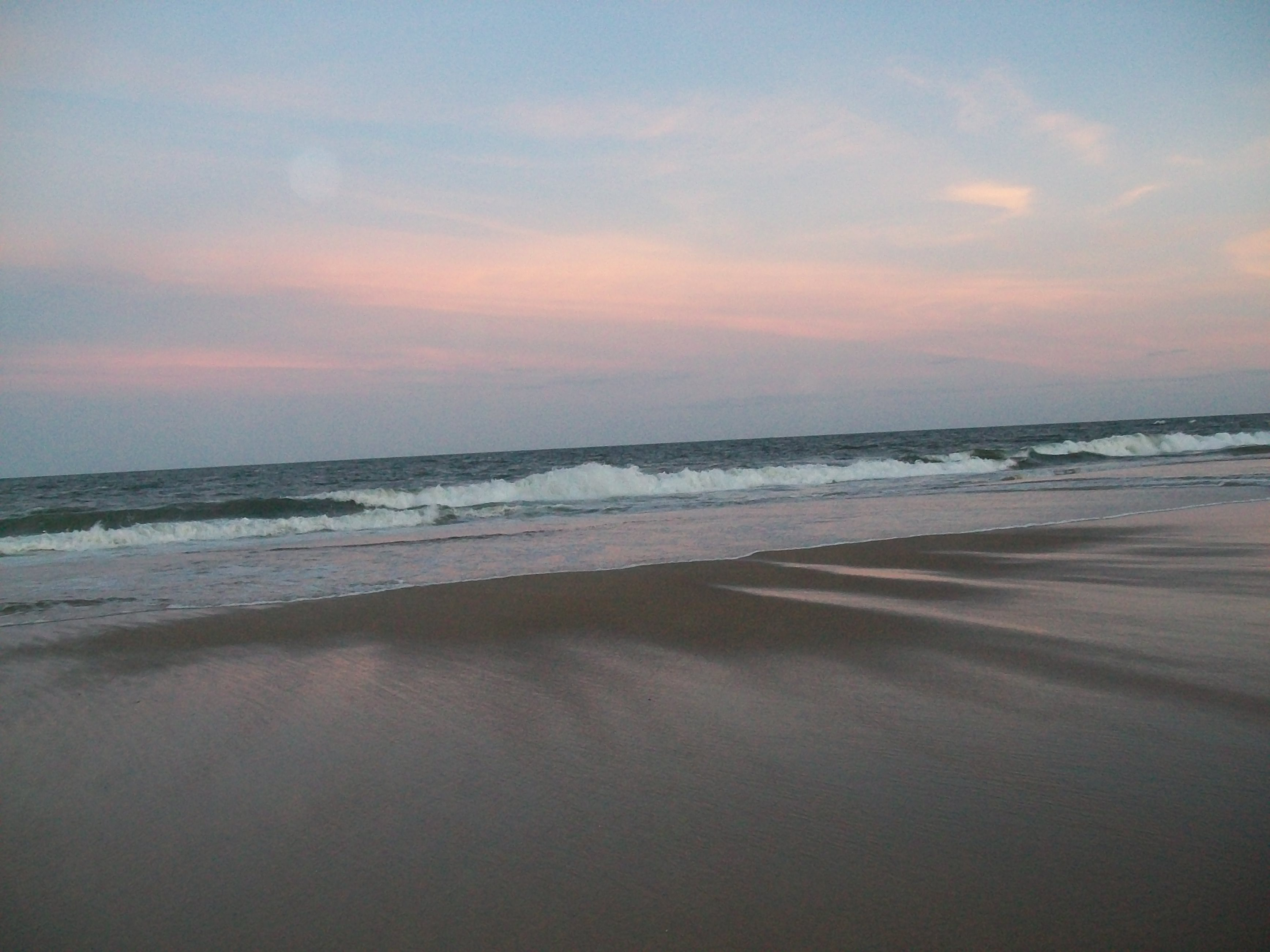 The sunset glow on Fenwick Island's shore