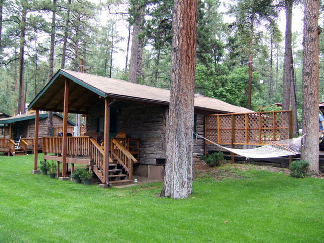 ‪Forest Home Cabins‬