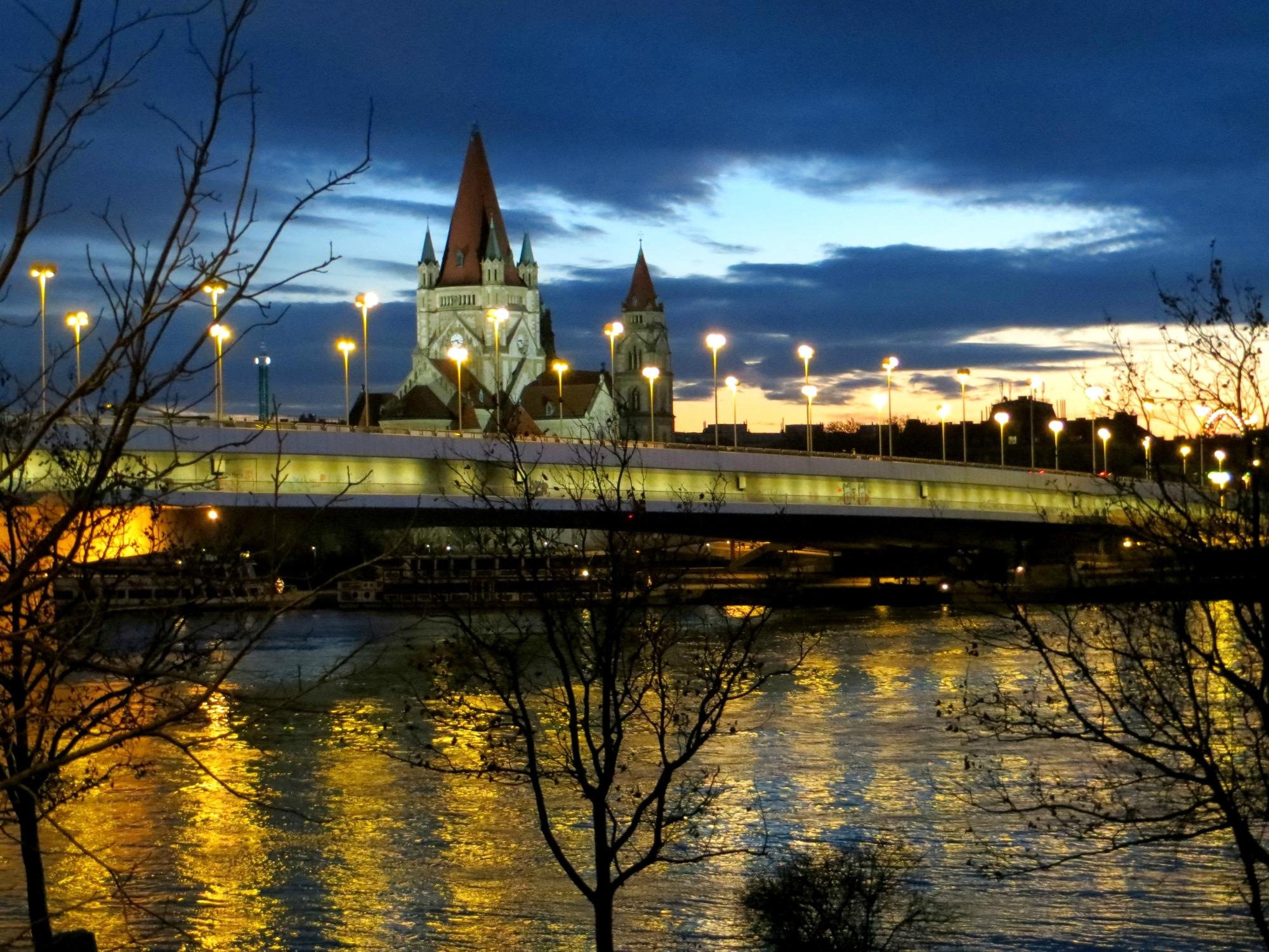 A bridge over Danube river captured with lights and reflections!
