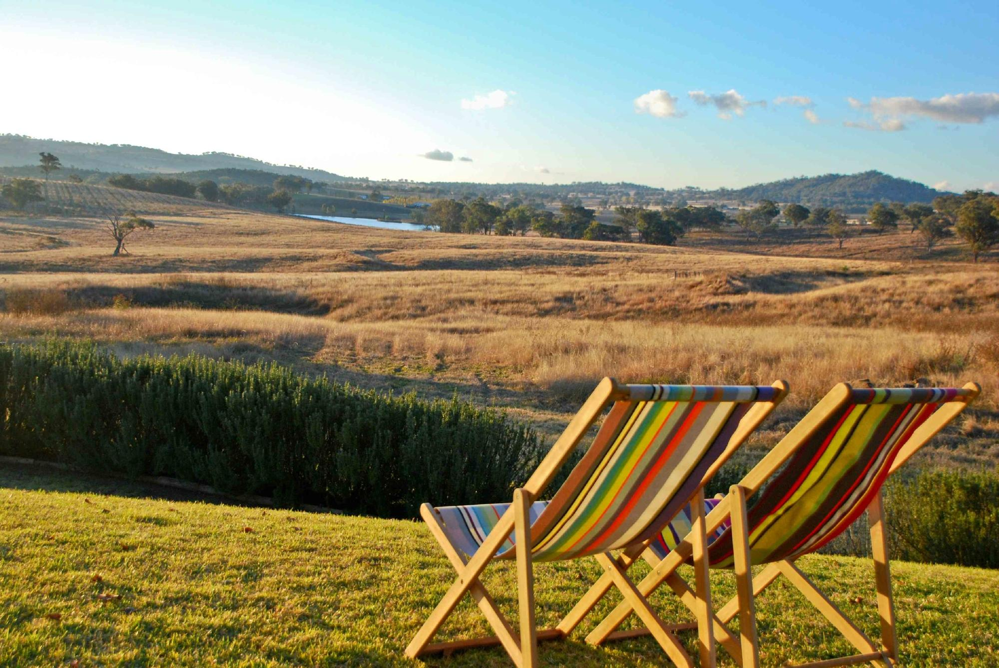 Two chairs set up looking over Mudgee scenery