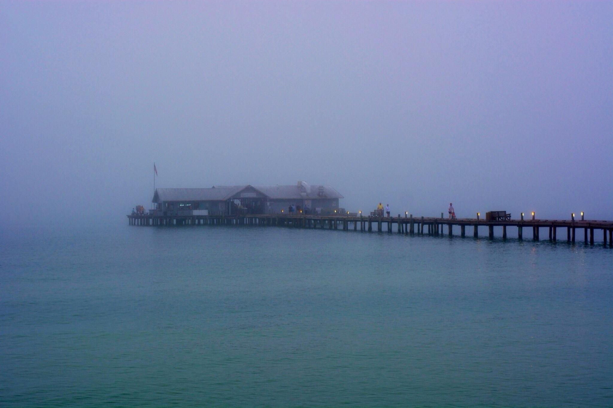 Pier in a foggy night