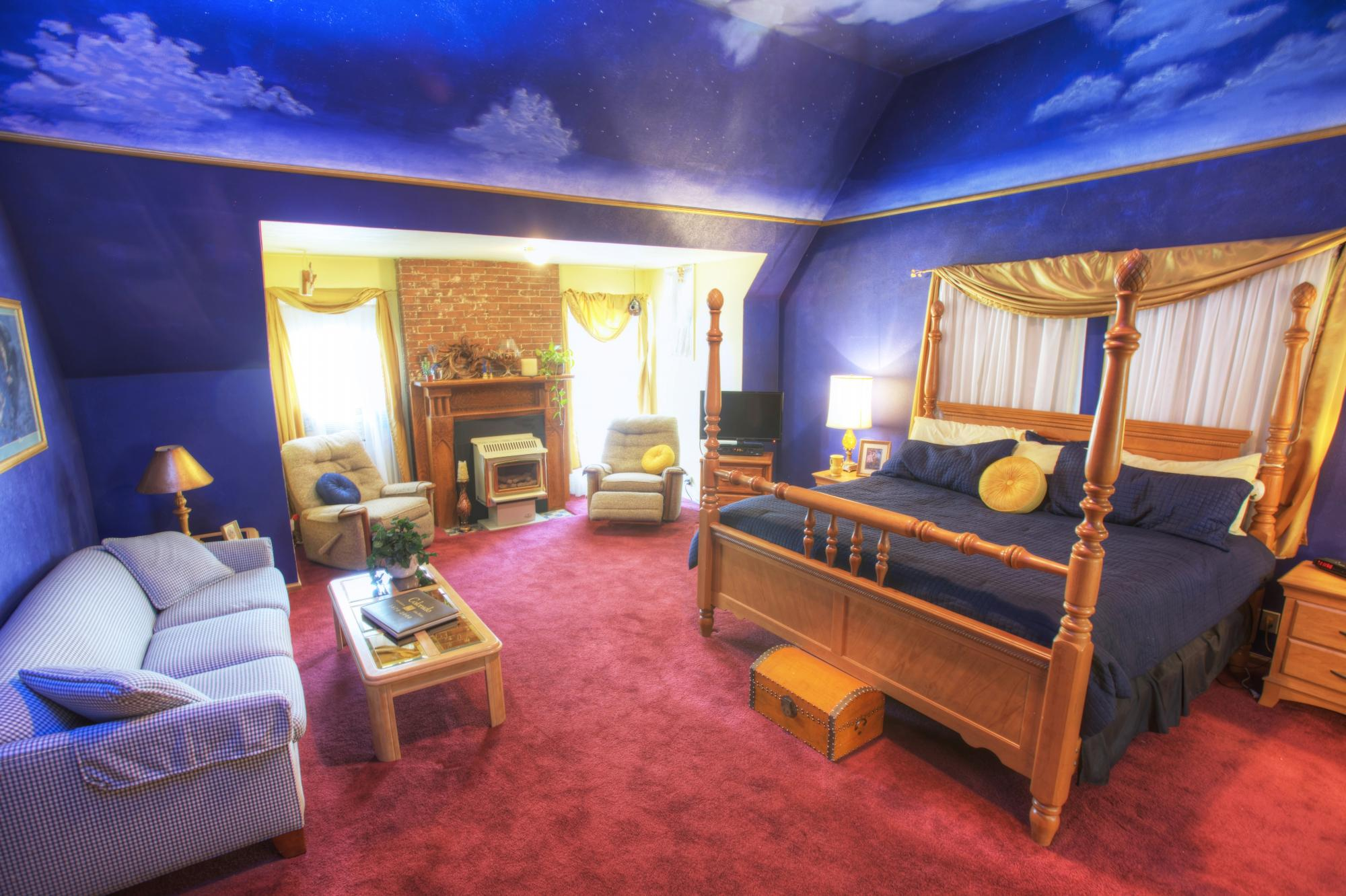 Adagio Hotel Room with Purple painted walls and white clouds.