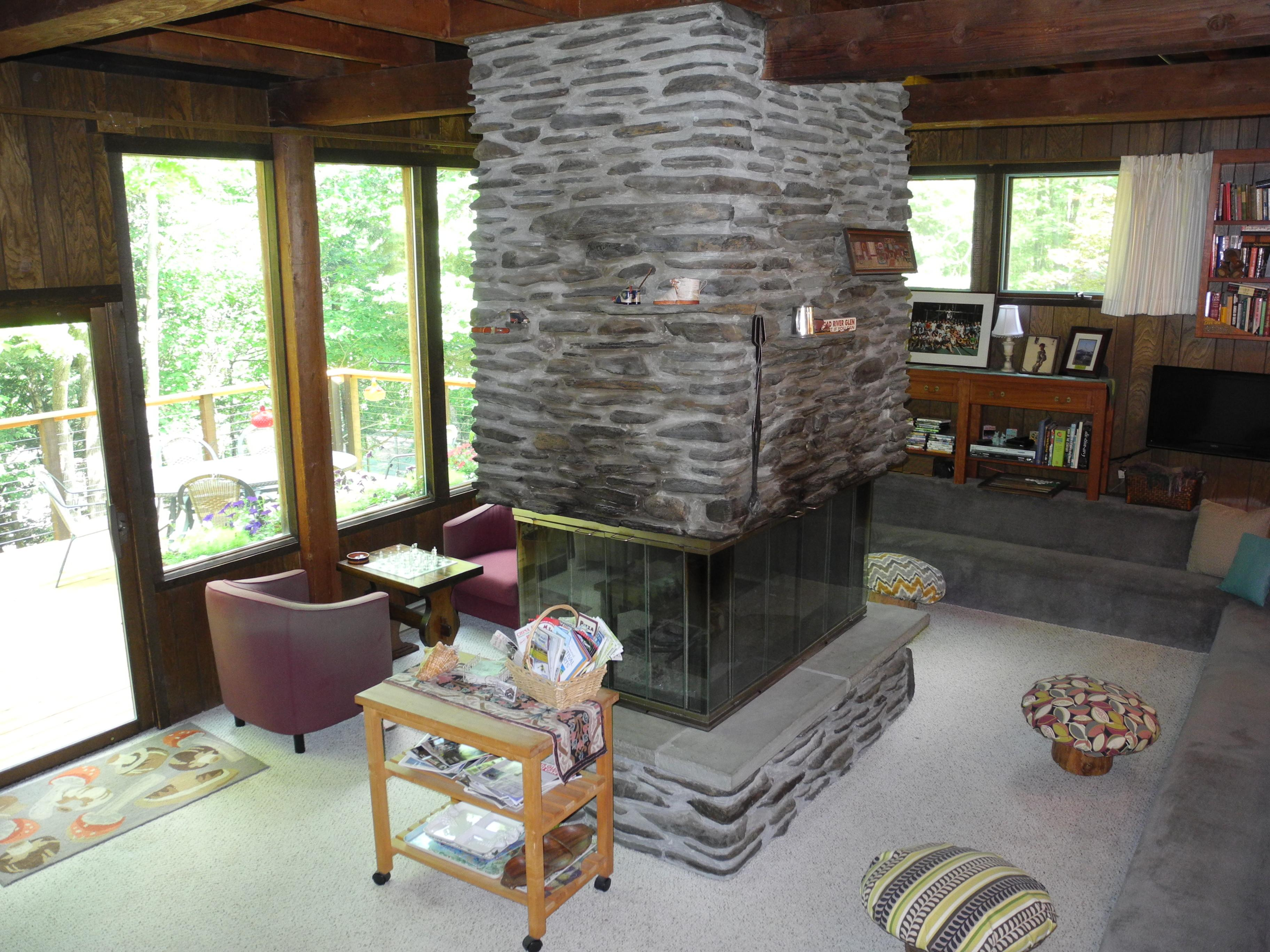 Living room with four sided fire place