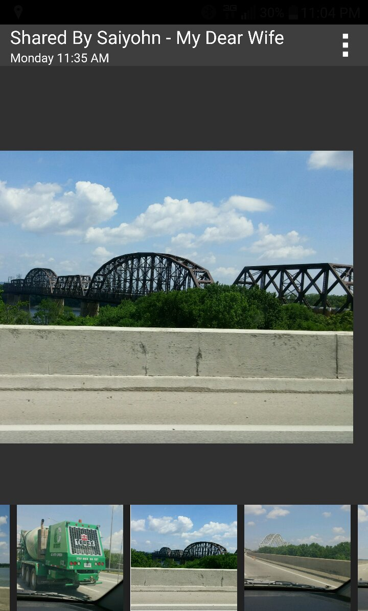 Ohio River. Louisville is a City of Bridges! Border of Indiana state line. Seen giant mural of M