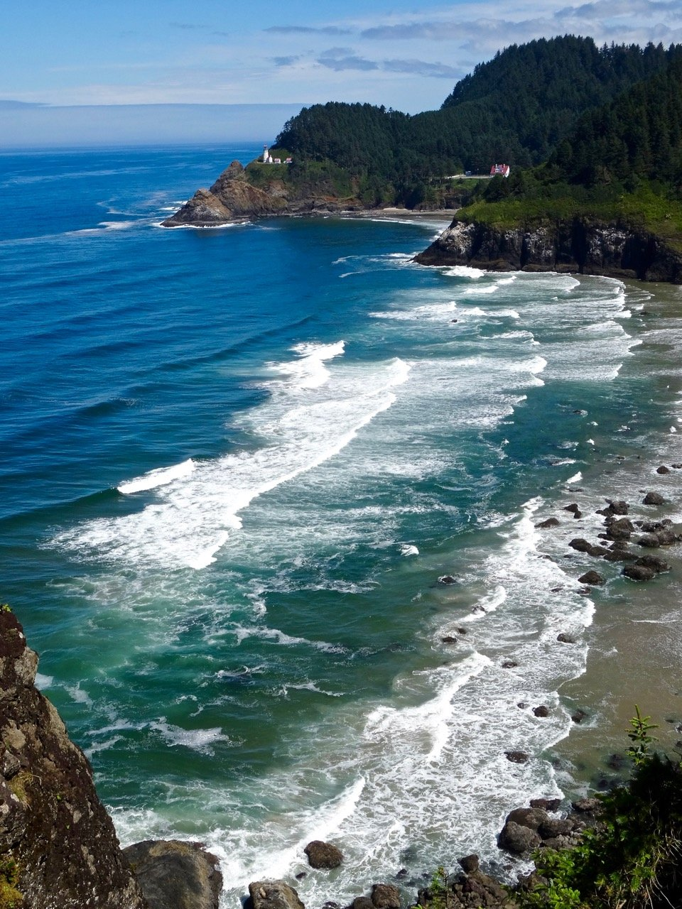 Beach View of Heceta Head Lighthouse in Promontory in Distance