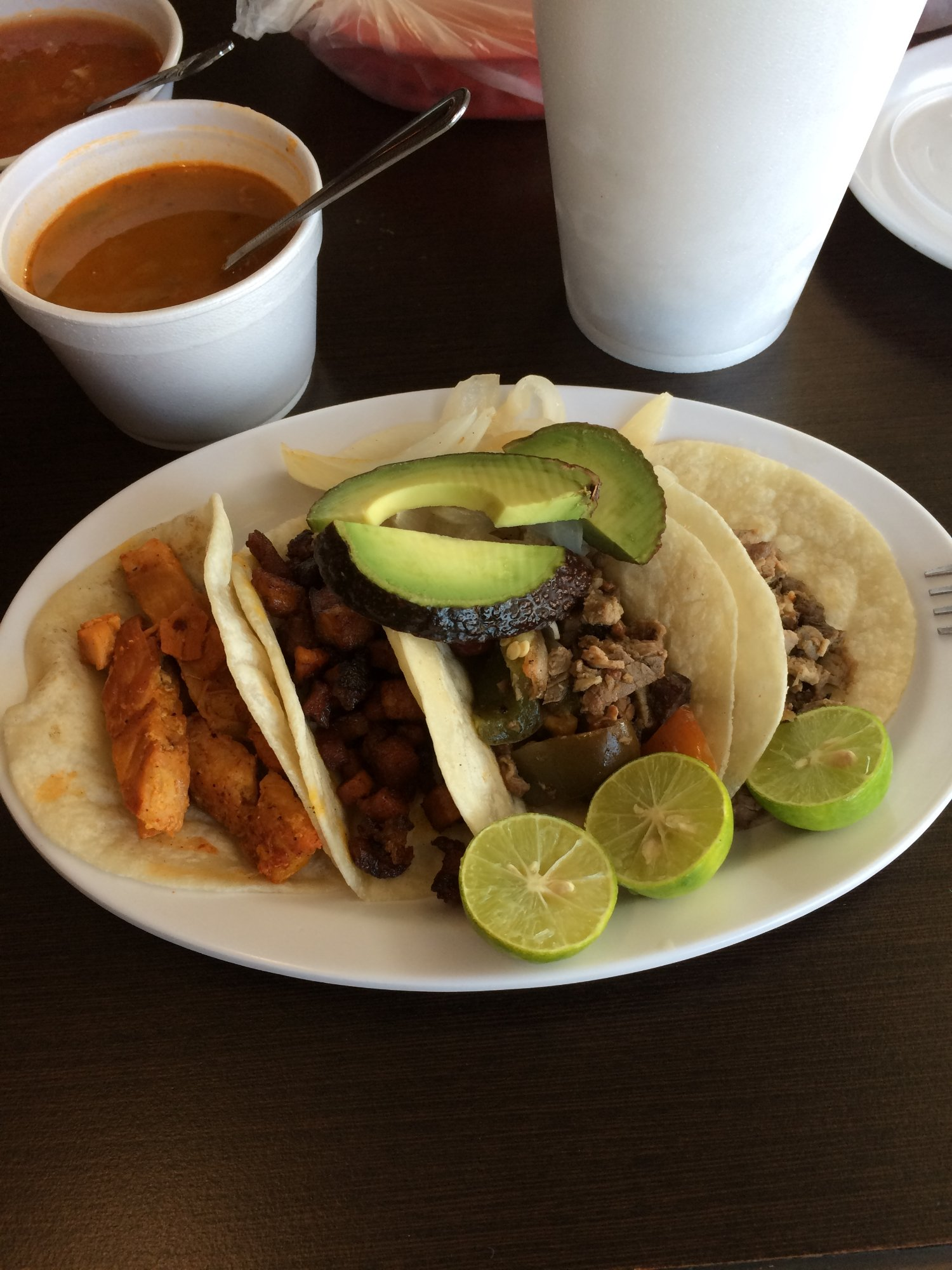 My tacos, Pork, Beef, Skewered Beef and Chicken just as the were served to me.