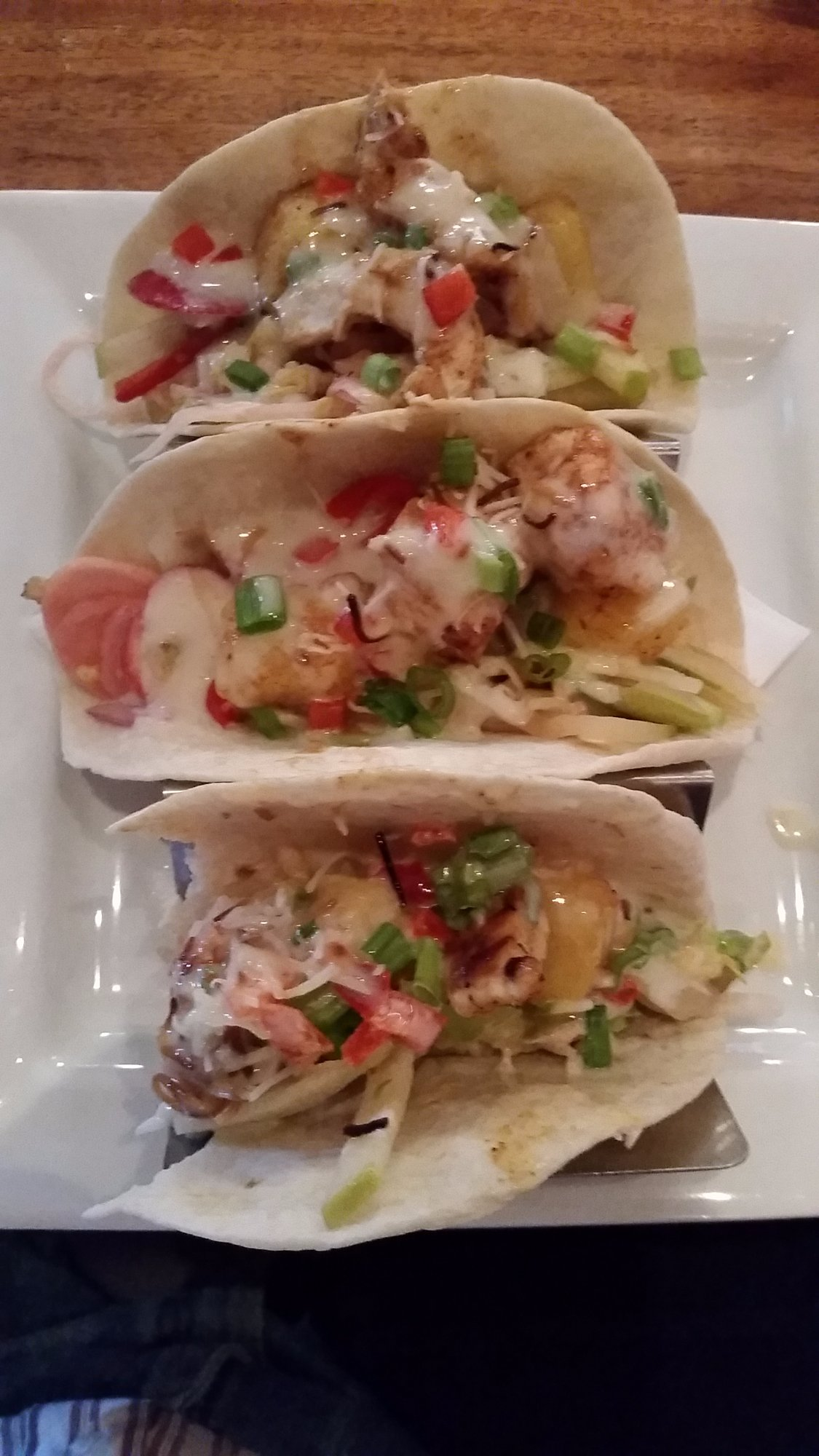 My Island Topper Tacos minus a bite. Eat them slow as you get to taste each element separately a