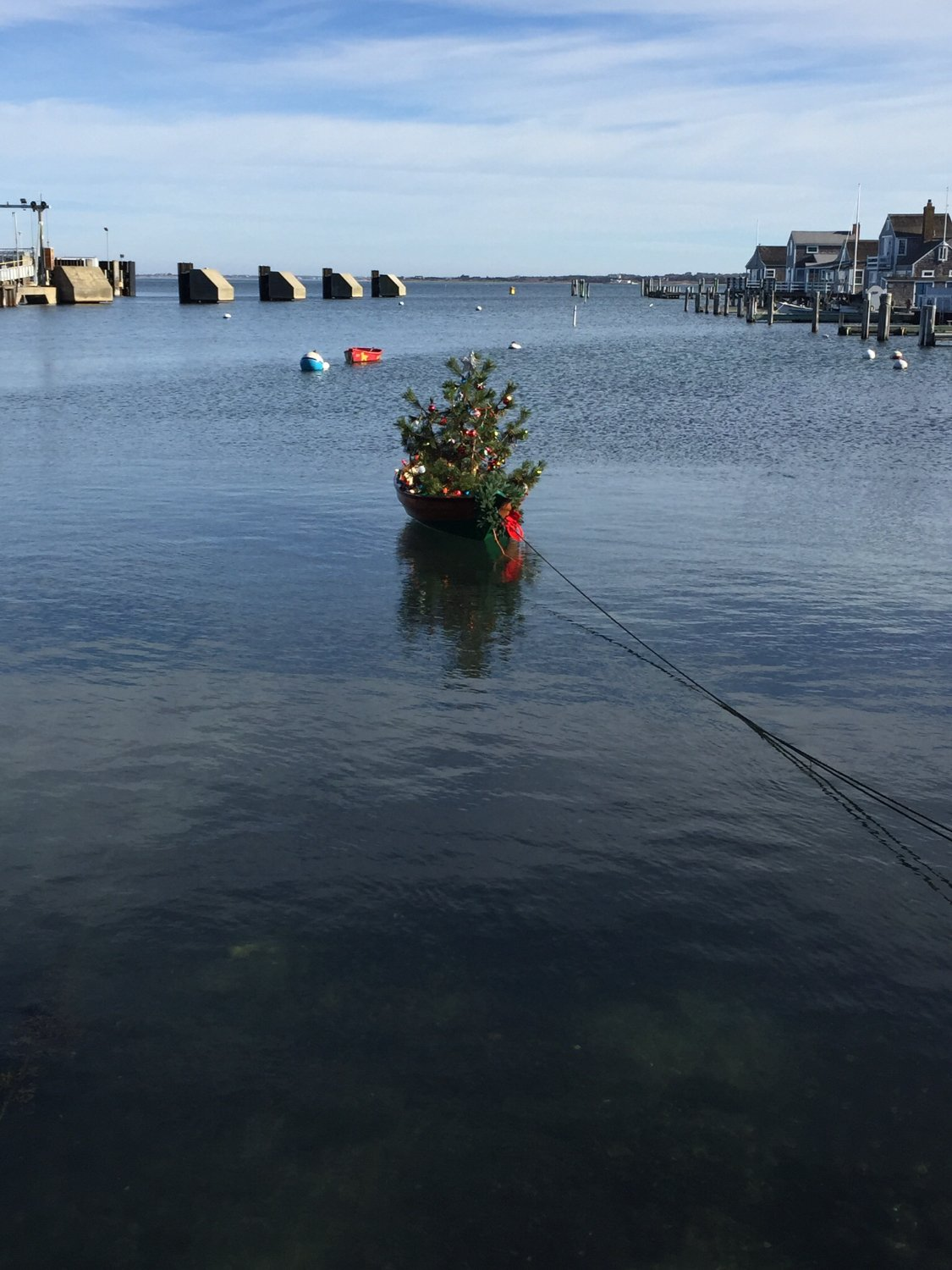 The famous little row boat adorned in its holiday attire
