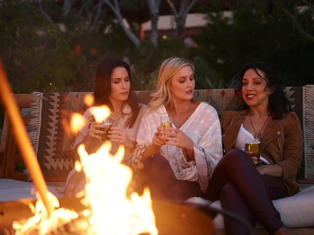 Enjoy a sunset around a fire at the Four Seasons Resort