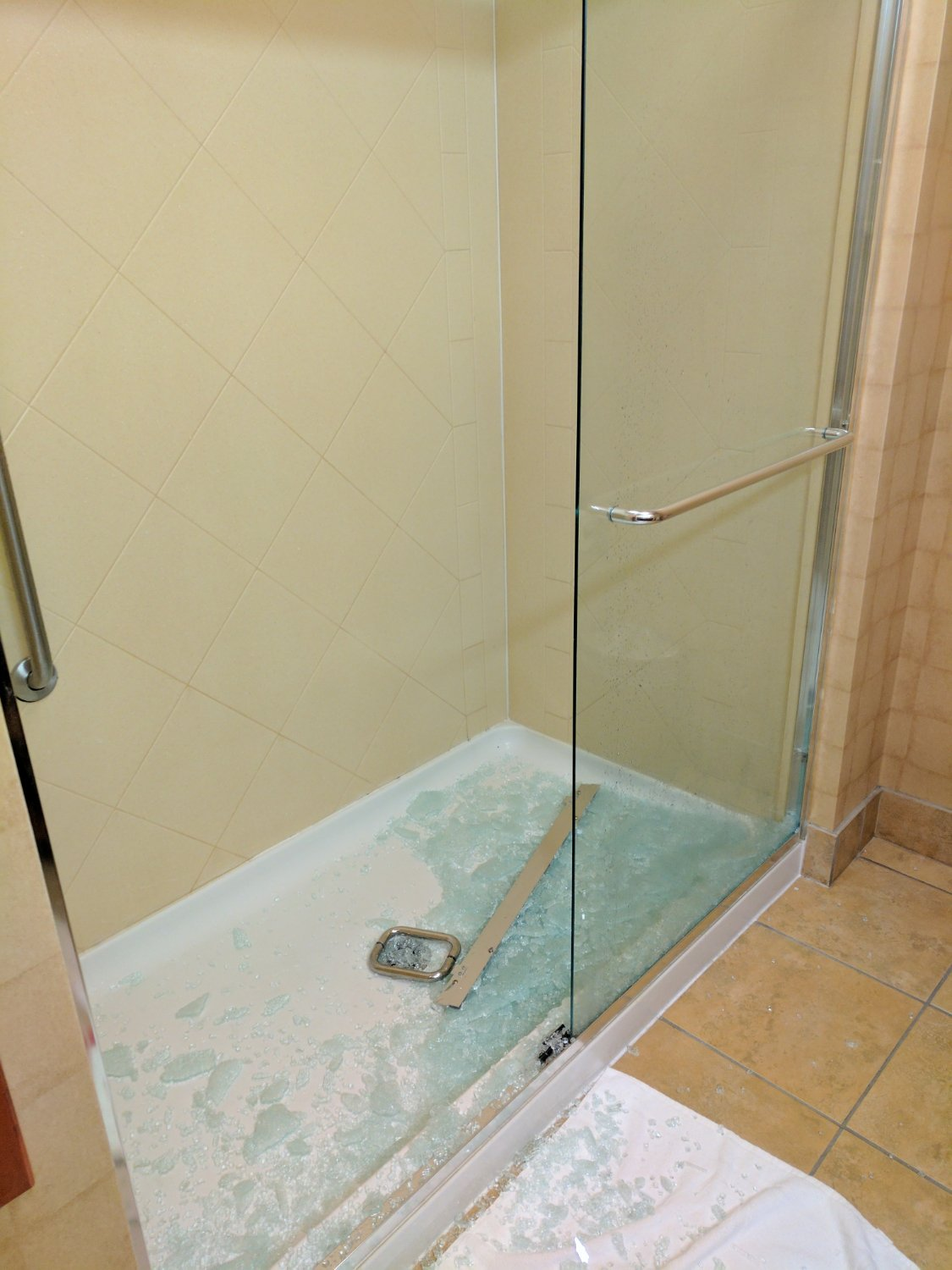 The glass shower door completely shattered. I was lucky to avoid any catastrophic injury.