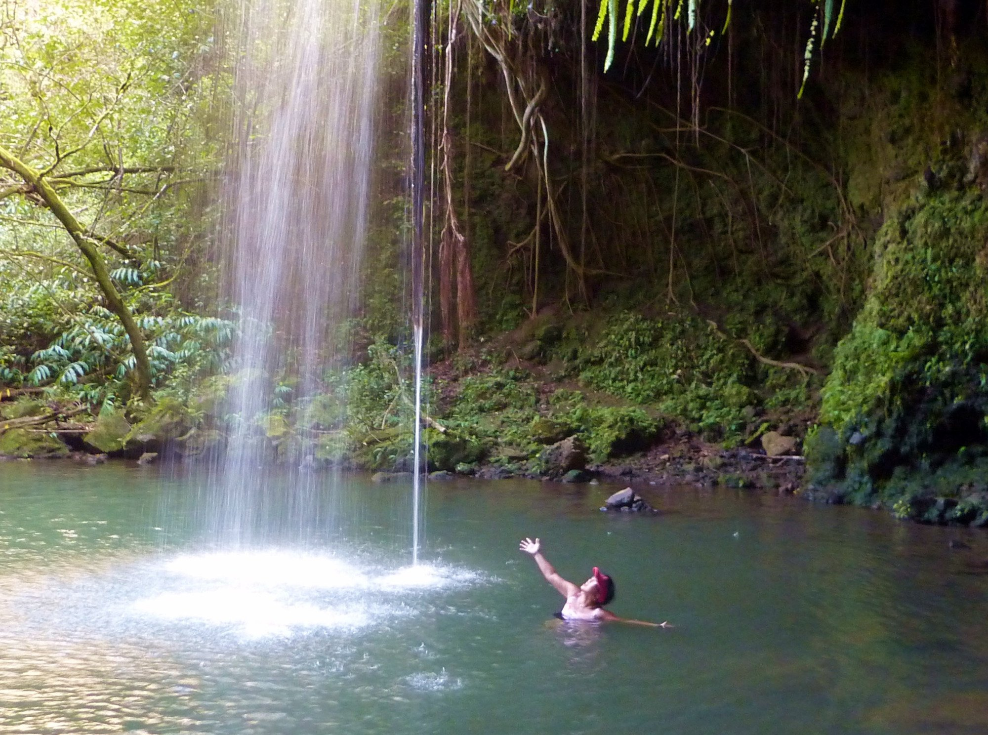 Wife is swimming under the Twin Falls, Maui.  (Don't stand under the falls, falling objects!)