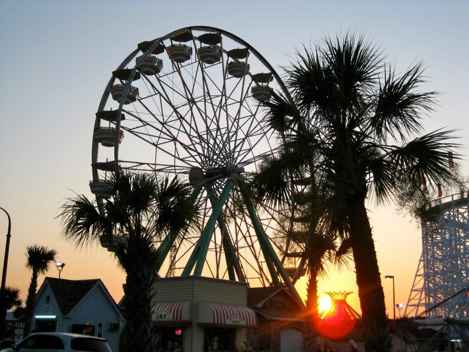 Ferris wheel and sun setting in Myrtle Beach