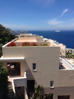 View from our terrace overlooking other hotel room with the Aegean sea as a backdrop