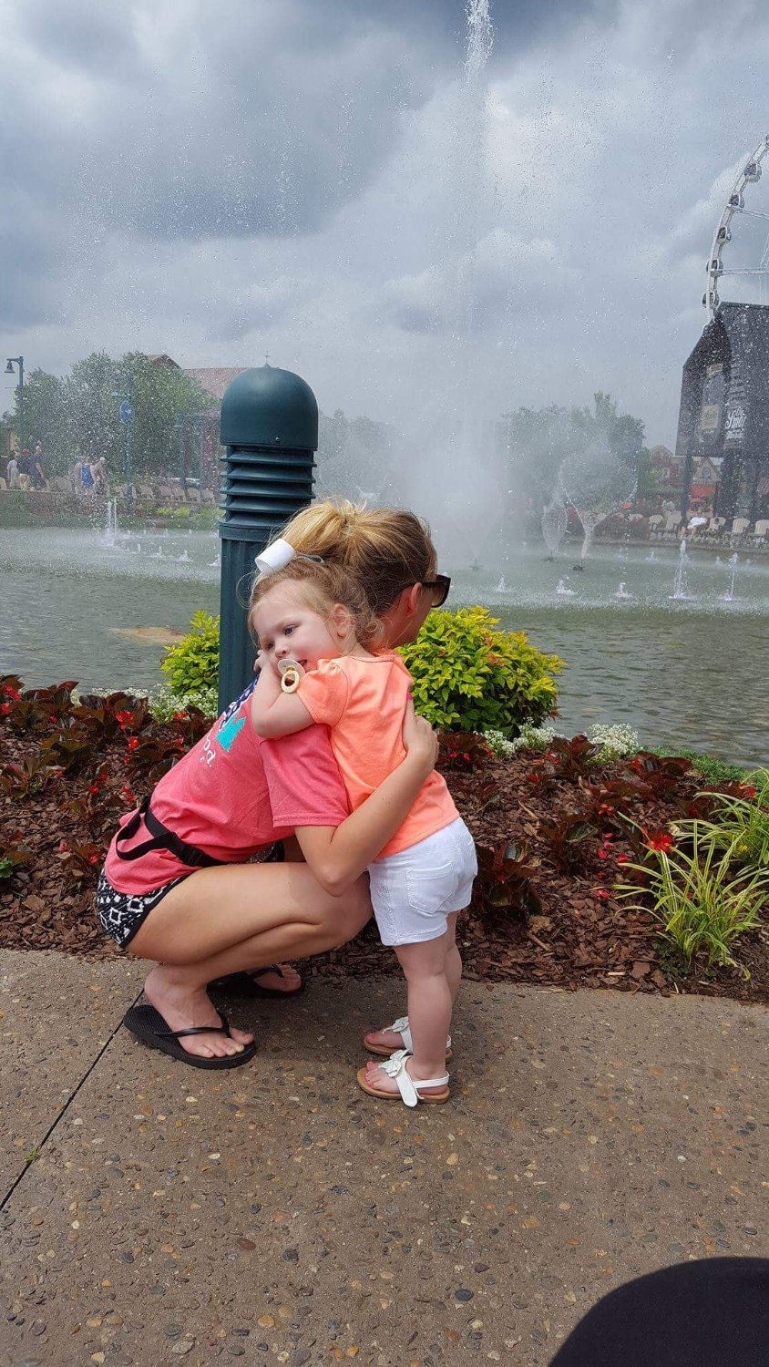 My daughter and granddaughter in front of the water.