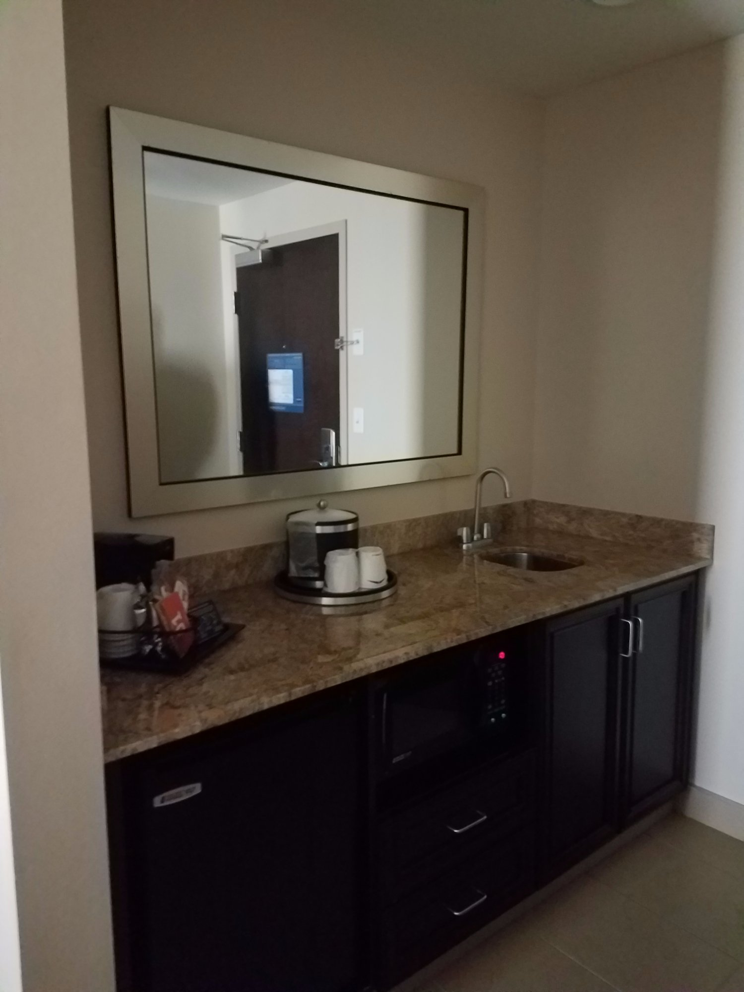 This is the coffee area with a refrigerator and sink that is right as you come in the room.