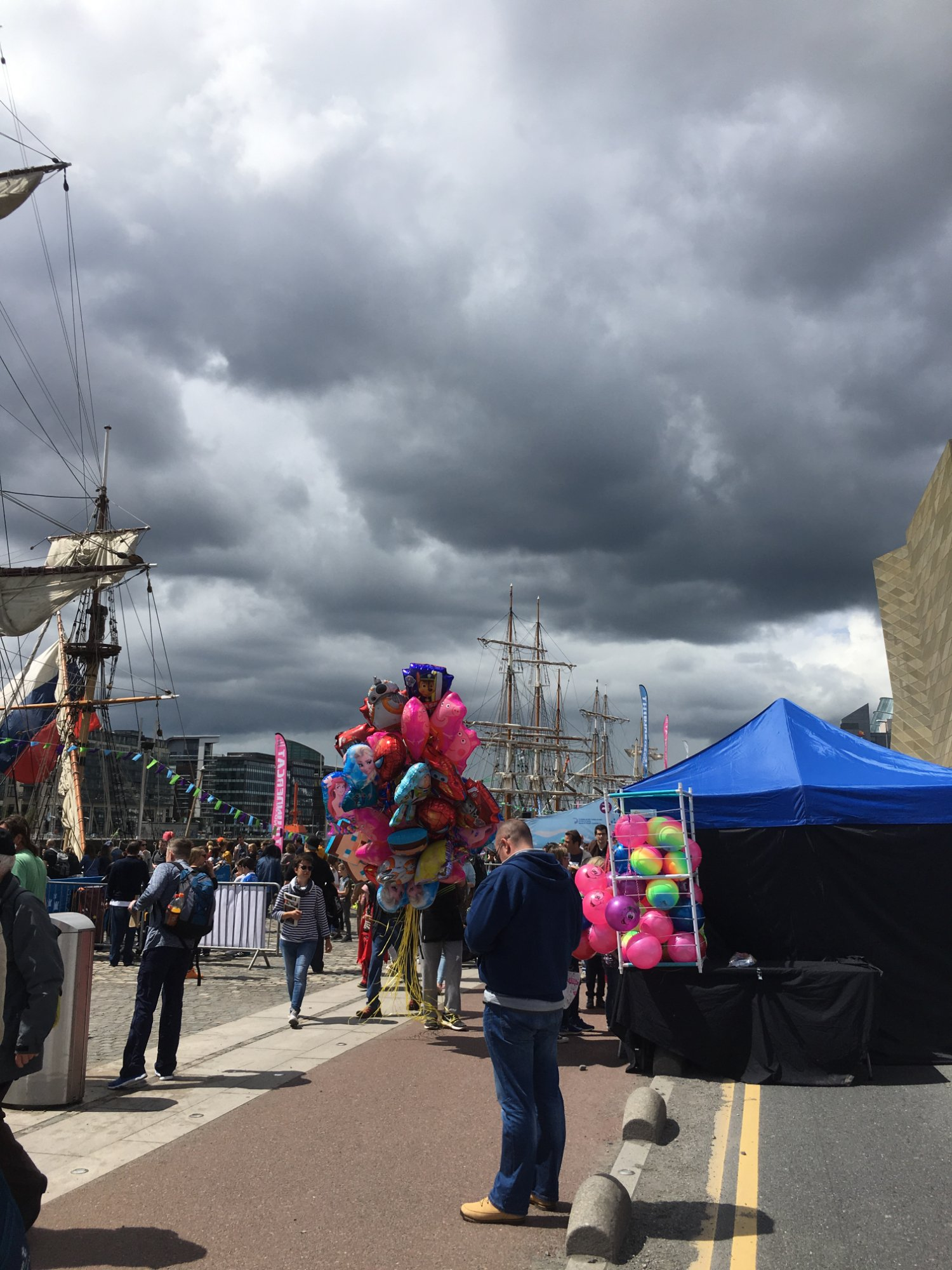 Ominous clouds over the bright festival