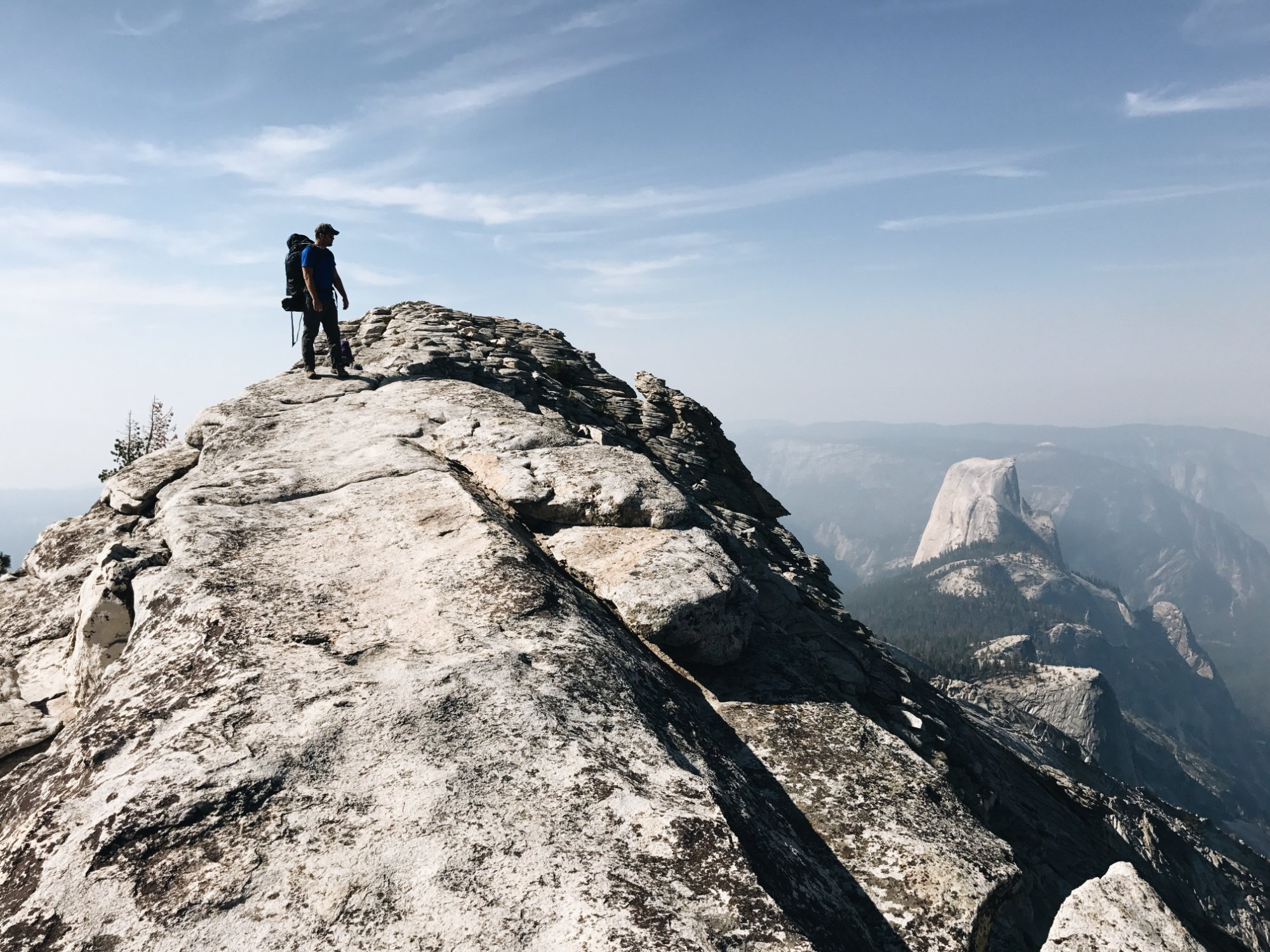 Standing on Cloud's Rest with a view of Half Dome.