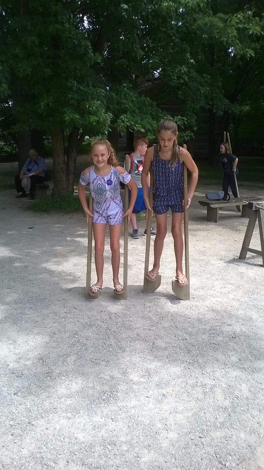 Trying out stilts in Prairietown