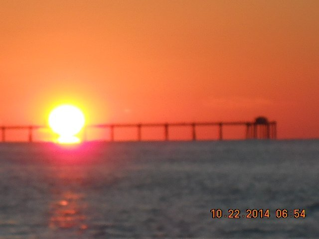 Sunset from Waters Edge condos looking at fishing pier.