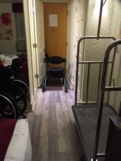 This room is so narrow that you can't get a walker let alone a wheelchair around the room. The bathroom is impossible small and the bathroom door springs shut. I had to tie it to the front door handle so my husband could get in and out.