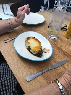 The egg plant dish filled with mince and topped with cheese