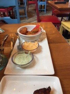 Yuca Cheese sticks with sriracha aioli sauce and a cilantro crema sauce. Yummy