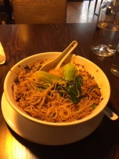 Spicy Sour Soup Noodles dish with ground pork and baby bok choy