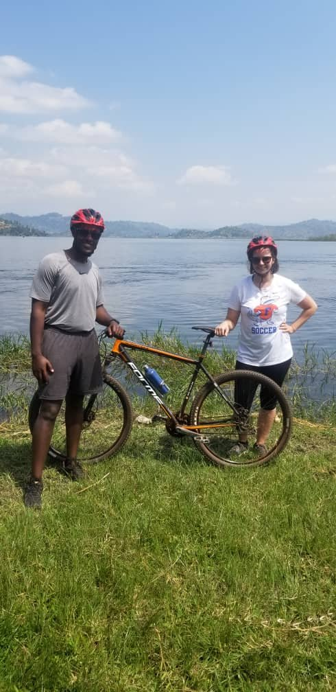 Taking a break before getting on the boat with our bikes. This is lake Ruhondo.