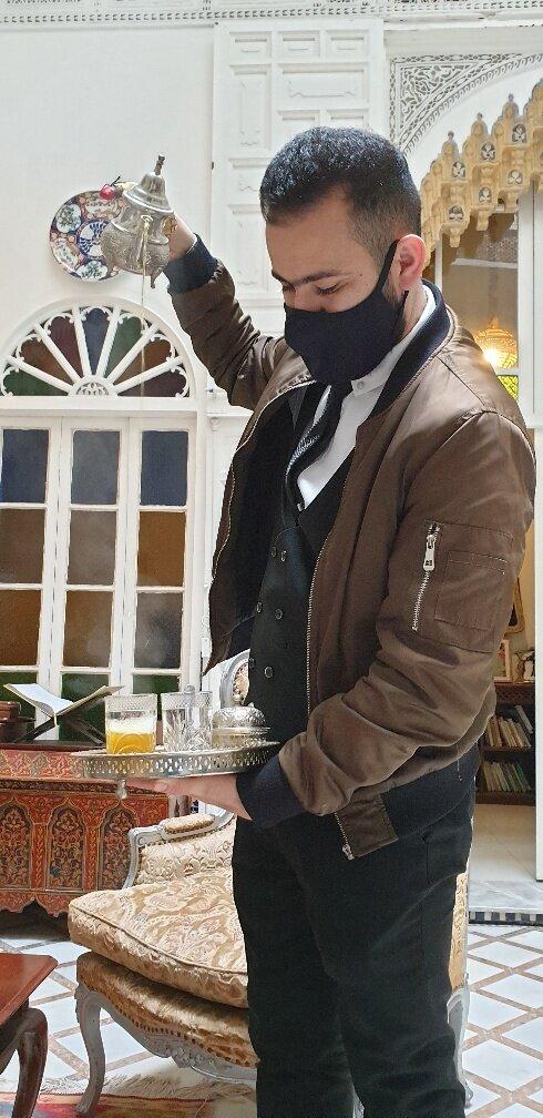 Hicham pouring a tea