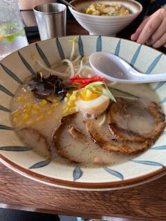 Japanese ramen with bone broth (foreground), and 'Katsu Don'  rice dish with breaded pork.