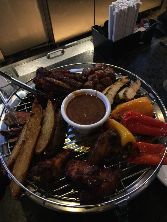 Dec 01, · Smokey Bones Bar & Fire Grill, Kissimmee: See 1, unbiased reviews of Smokey Bones Bar & Fire Grill, rated 4 of 5 on TripAdvisor and ranked #45 of restaurants in Kissimmee.4/4(K).