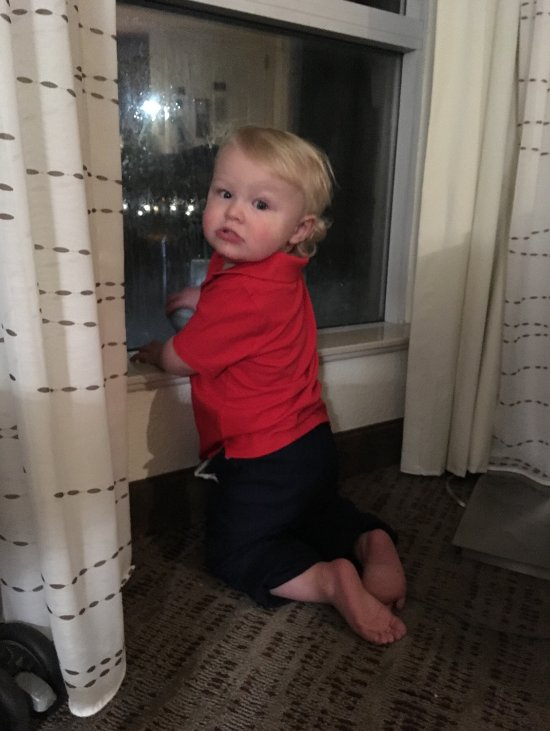 Grandson looking out large window. Staff was so cute with him.