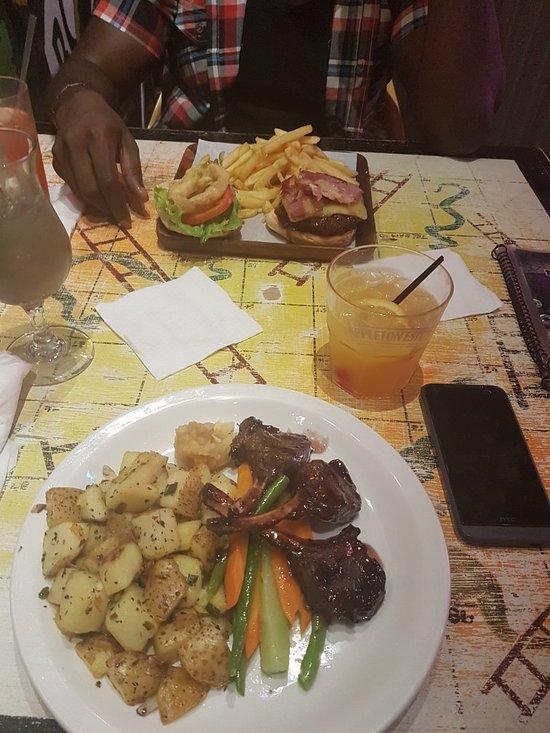 Usain bolt 39 s tracks records kingston 67 constant spring road 6 restaurant reviews phone for Spring garden jamaican restaurant
