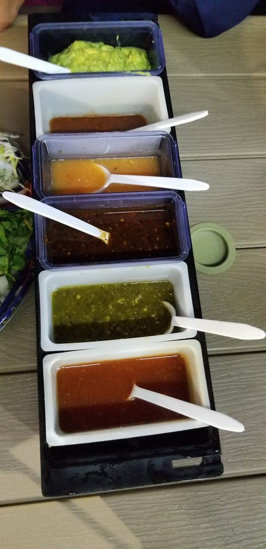 Condiments at each table with fresh Guacamole (end)