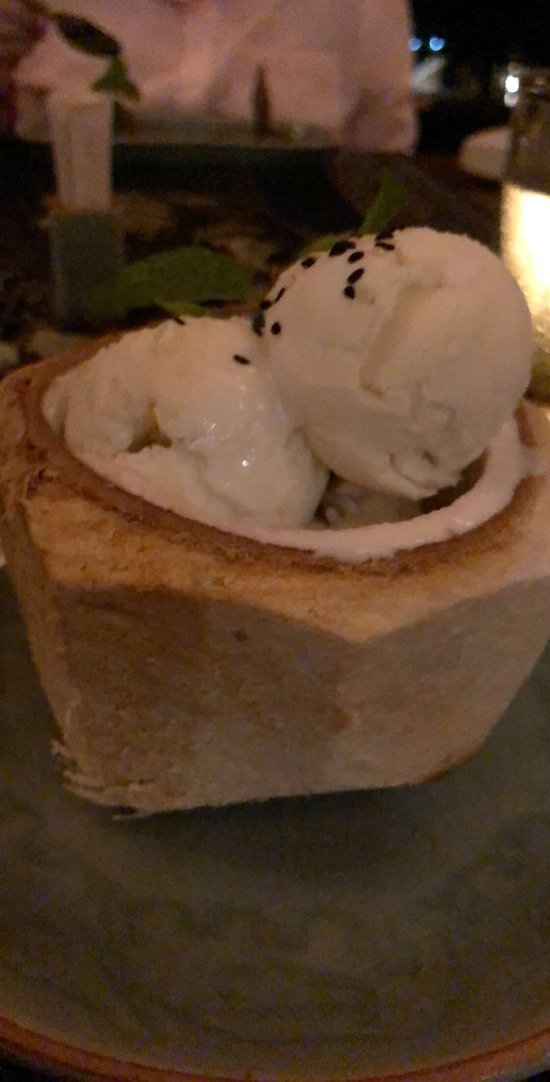 Home made coconut ice cream and black sticky rice in whole coconut dessert! Yum