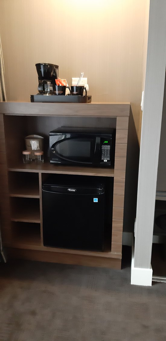 all the amenities you need including a small microwave oven and a bar fridge and coffee maker,