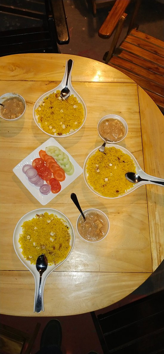 veg pulao with paneer and green salad