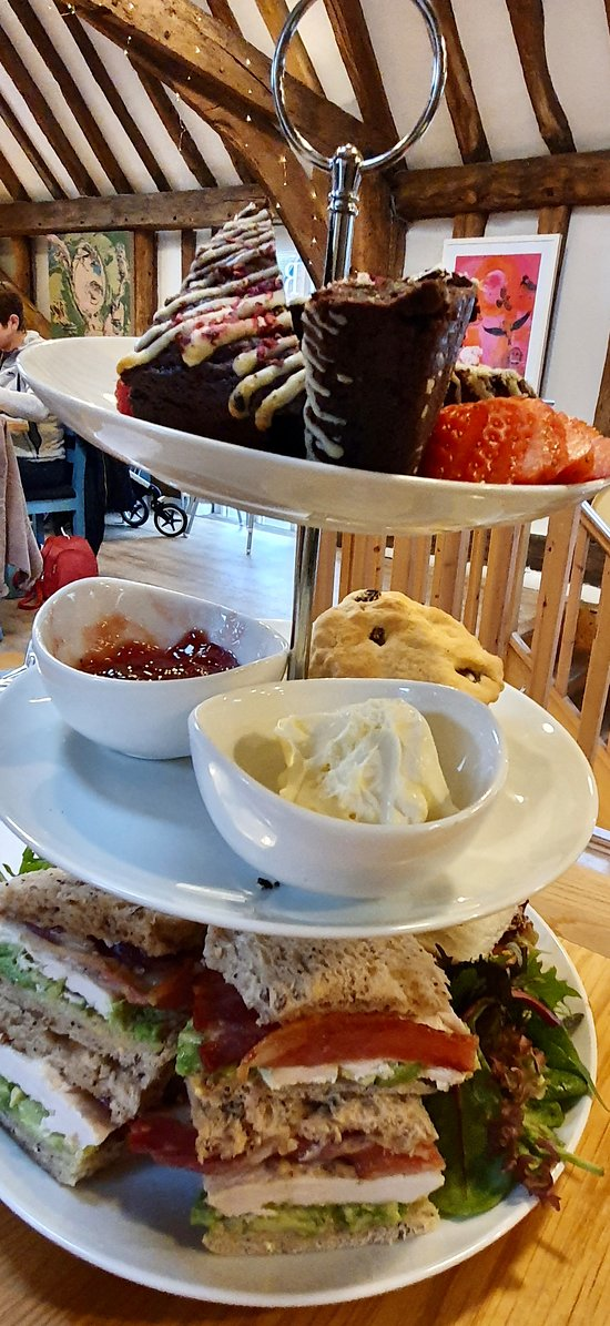 Sandwiches were ploughman's (cheese, ham, mixed leaf salad & pickle) and chicken, bacon and avocado salad. Fruit scones with clotted cream and jam followed by raspberry chocolate brownies.